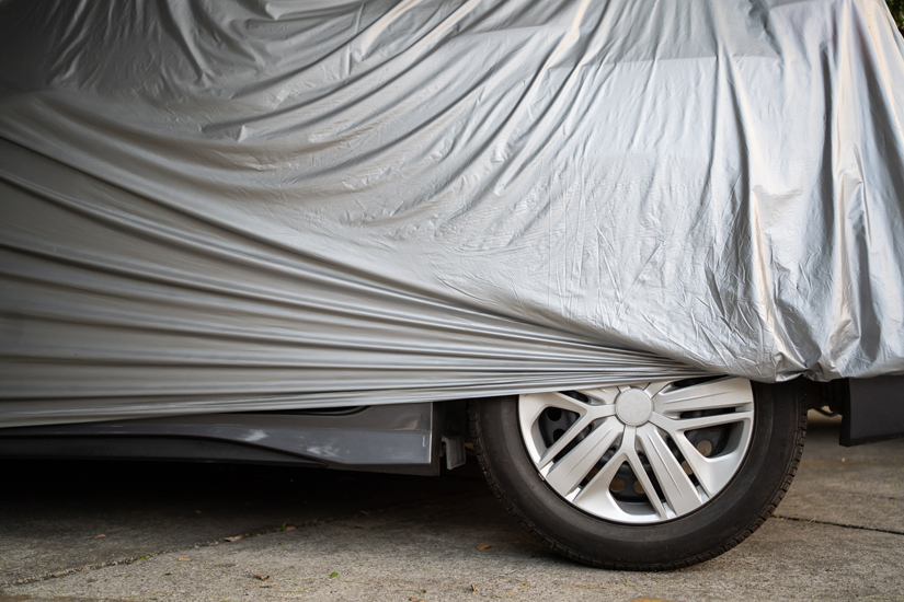 Car covered with waterproof cloth